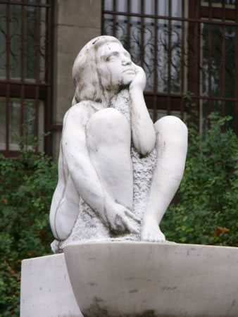 """Pensive     statue (""""what's next?"""")"""