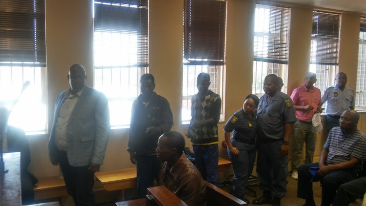 Kaizer Chiefs legend Mike Mangena arrives with his co-accused in the Randfontein Magistrate's Court on Friday.