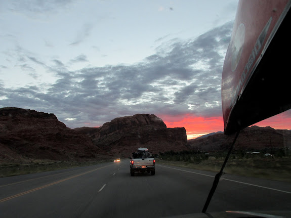Following Wade and Lyman into a colorful sunrise at Moab