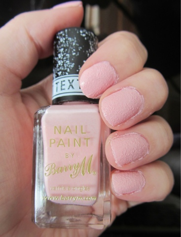 A picture of Roxy's Box of Tricks nails with Kingsland road applied showing pink