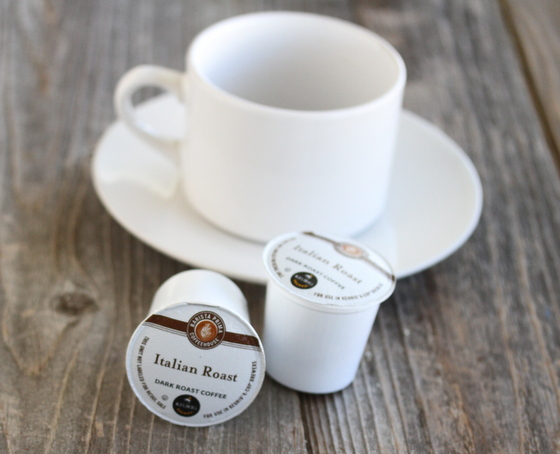 photo of two coffee k-cups with a coffee mug