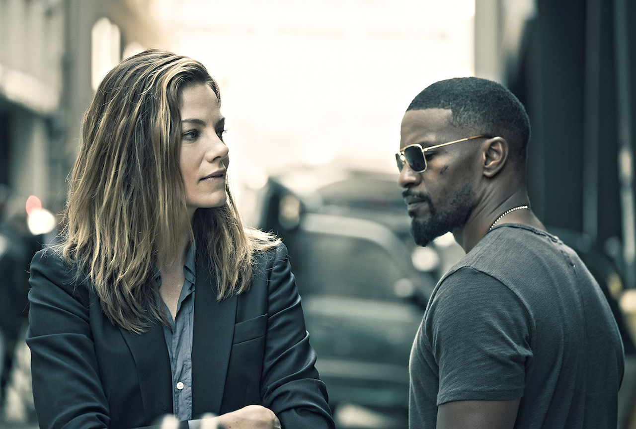 Michelle Monaghan and Jamie Foxx in SLEEPLESS. (Photo by Erica Parise / courtesy of Open Road Films).