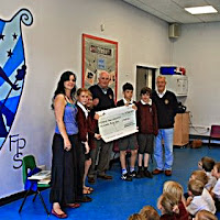 9th June 2014 Donation of £500 to stock Libary at Fitzmaurice Primary School