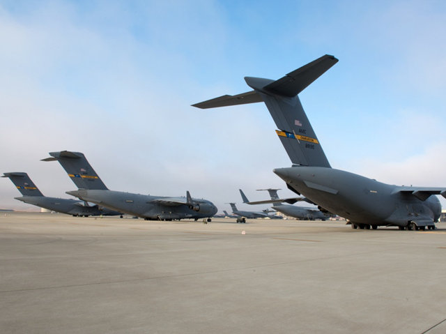 Three C-17 Globemaster IIIs from Joint Base Charleston, South Carolina, sit on the tarmac at Travis Air Force Base, California., on 8 September 2017. They were staging at Travis because of Hurricane Irma. Photo: Louis Briscese / U.S. Air Force