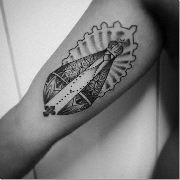 tatuaje_de_nuestra_señora_de_aparecida_en_el_brazo