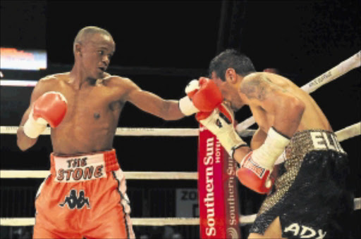 Malcolm Klassen (orange trunks) and Daniel Lomeli during the WBF super featherweight title bout at Montecasino in Johannesburg.