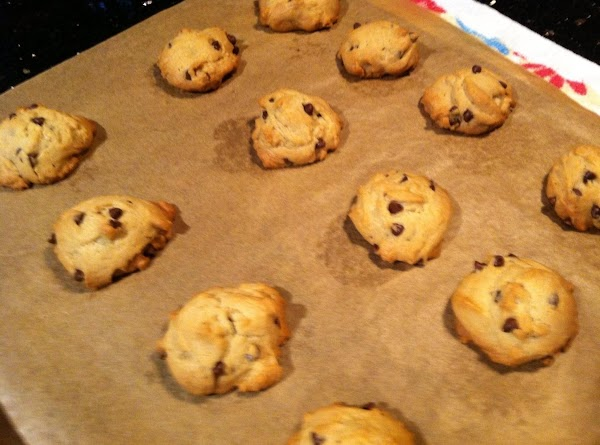 PUT TSP  OF MIXTURE ON A PARCHMENT LINED COOKIE SHEET N BAKE IN...