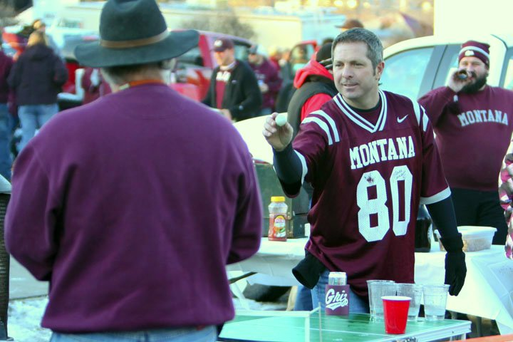 Tailgate beer pong action to warm up before the game.