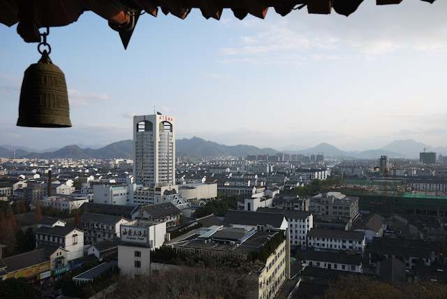 view from Yingtian Pagoda of an urban area with mountains in the background