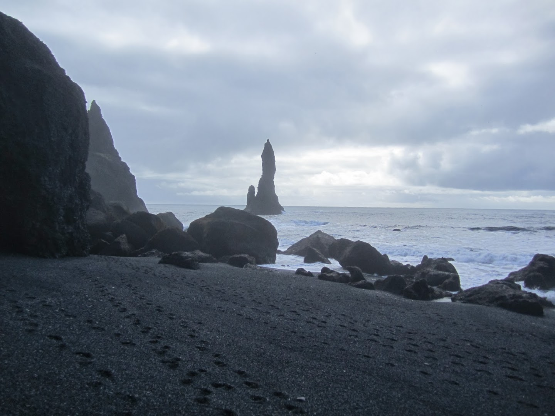 Black sands on the beach at Reynisdrangar. VK