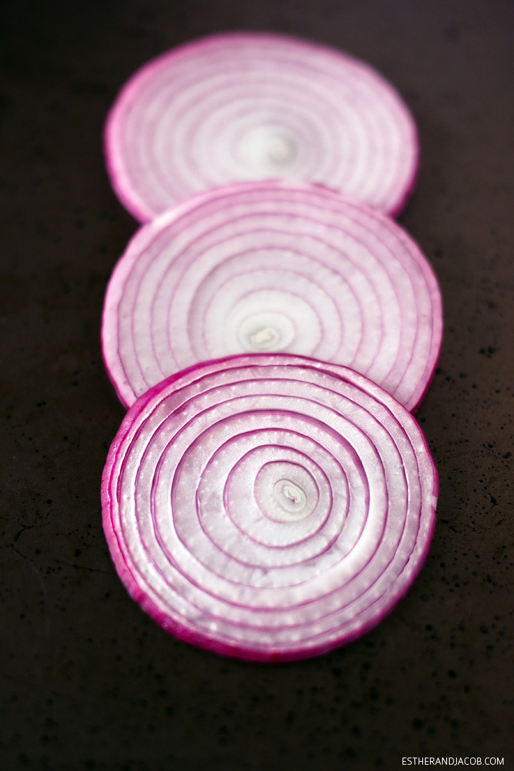 Onions perfectly sliced by my new mandoline for my lemon citrus spinach salad recipe.
