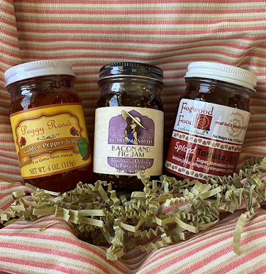 A gift box containing three NC jams such as pepper jelly, blackberry jam and bacon and fig jam.