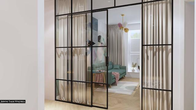 Loftowa ścianka w pastelowym, domowym gabinecie.