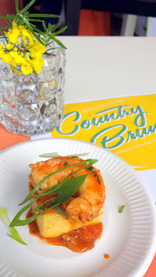 Portland Monthly Country Brunch 2016 - Brunch Bite by Screen Door of Shrimp & Grits, wild caught gulf shrimp sauteed with country ham, garlic, tomato, and white wine over parmesan spoon bread