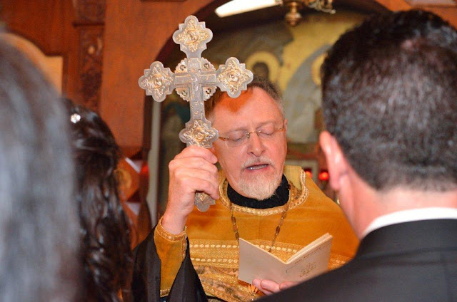 The blessing with the cross at the dismissal