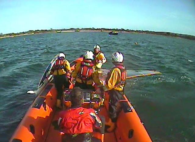 Poole ILB crew assist a windsufer in the harbour - 11 April 2015