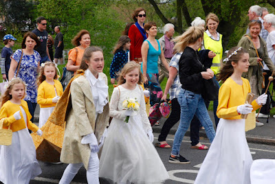 The 2016 May Prince, Millie Bentley, and May Queen, Evie Doolin, take centre stage during the procession
