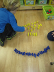 Children sorting manipulatives by color.