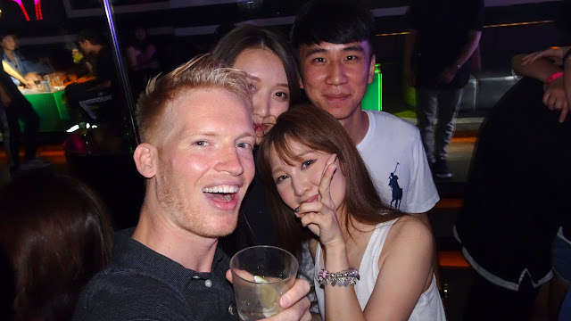 having a drink with the locals at MUSE Tainan Nightclub in Taiwan in Tainan, T'ai-nan, Taiwan