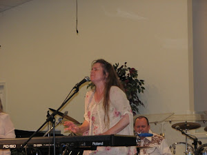 Susan singing under the anointing.