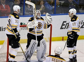 Tim Thomas and the Bruins celebrate a win over the Blues
