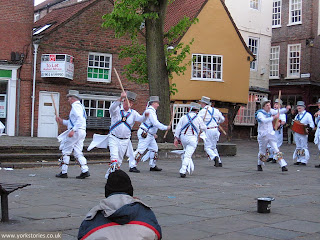 Morris dancers in King's Square, May evening 2013. No obvious problems with the paving here