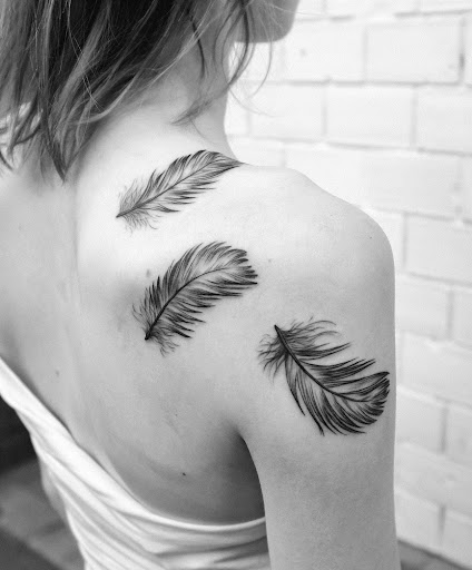 50 best feather tattoo designs and ideas rh tattoosme com angel feather tattoo images angel feather tattoo images