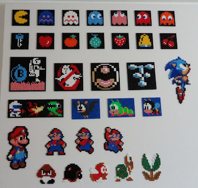 Pixel art made out of perler beads. These are different colours of little plastic beads which you place on a pin matt and iron to fix in place. You can make up lots of different retro gaming sprites. This is a collection of 32 of my favourites. Including pacman the pac man ghosts and all the fruit to collect in the game and sonic and wizball sprites plus lots of others