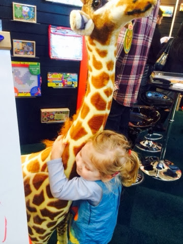 Maegan Clement with Melissa and Doug Giant Giraffe