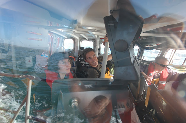 Crew members training inside wheelhouse of all-weather Tyne class lifeboat