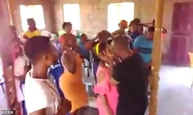 Zambian pastor kisses demons out of his female followers
