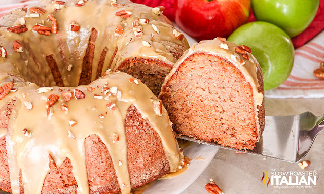 a slice of Caramel Glazed Apple Bundt Cake being taken