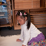 Preschool girl at private Montessori school in Huntington Beach working with color tablets for sensorial development.