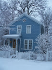 Hubbell Park blue house in snow