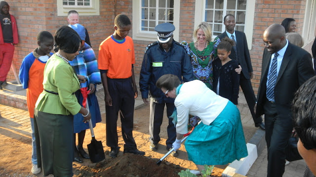 Princess Ann planting a tree at the new building site