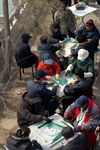 Retirees playing mahjong in a park