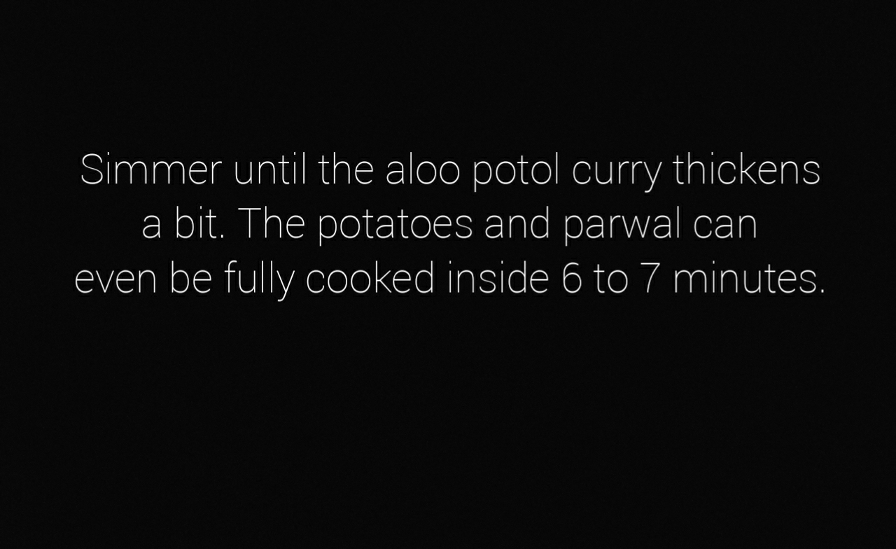 making aloo potol curry: