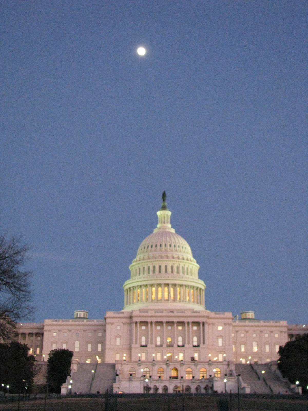 Photo of the U.S. Capital with full moon overhead.
