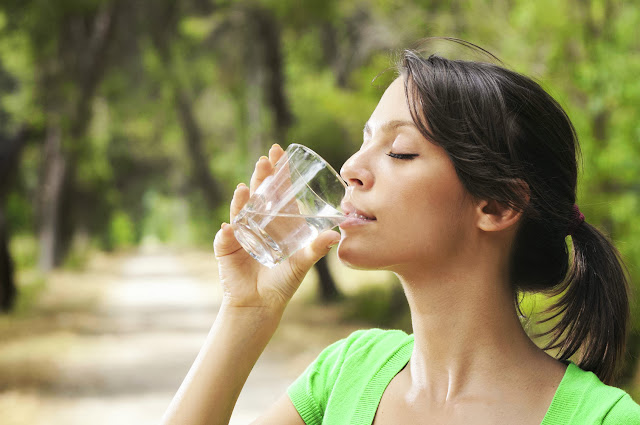 Woman Drinking Water | Stay Healthy and Look Young Naturally