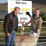 The Danny English Cup is presented by his nephew Pat Vesey to Liam Brennan  for best Crossbred Ewe Lamb (confined) at the Achill Sheep Show at Pattens Bar, Derreens Achill. Photo: © Michael Donnelly