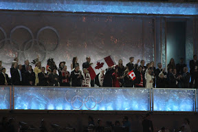 Dignitaries applauding the arrival of the athletes