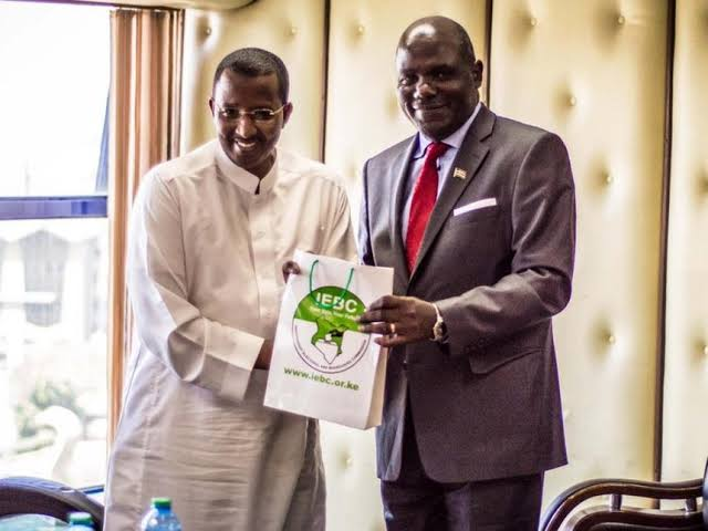 Ex IEBC boss Issack Hassan and current Chairman Wafula Chebukati. PHOTO | NMG