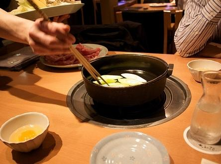 In this photo you can see the nabe pot on the table heating element...