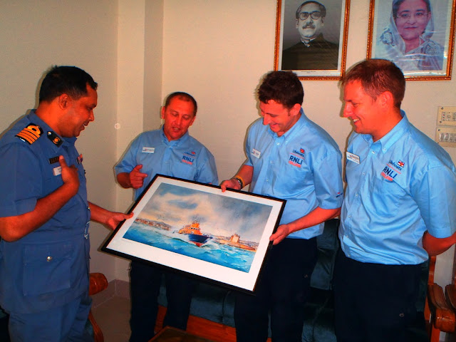 26 October 2012 - Bernie, Alex and Dave present a framed picture of a lifeboat to the Bangladeshi coastguard.