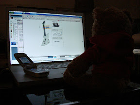 The Bear checking out MySpace while chatting on his cell phone.