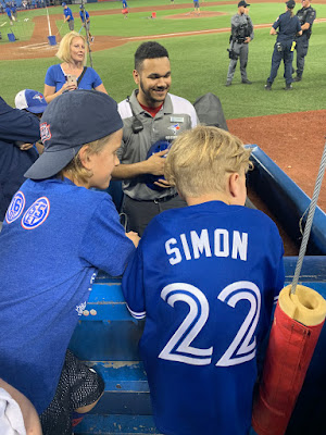 Kip Simon's son with his Pearls tee shirt and his brother at Rogers Centre