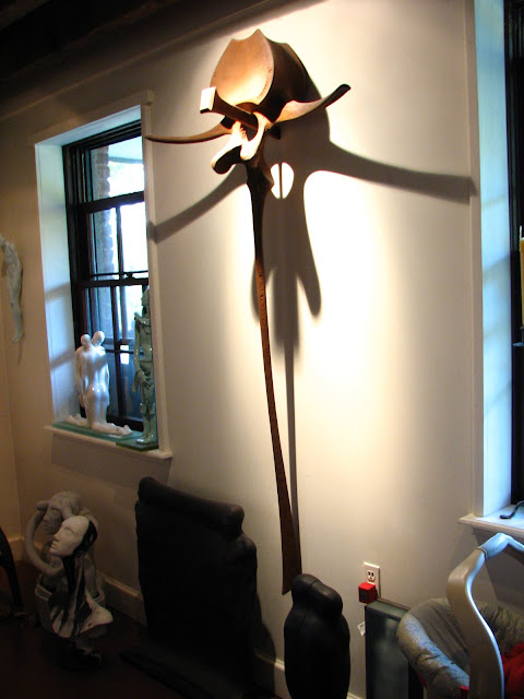 The piece on the wall is from the artist http://www.sculptorsam.com/.  Amazing fabrication skills.