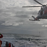 9 October 2011. Helicopter on approach to winch Poole lifeboat crew. Photo: Poole RNLI/Ade
