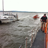 19 July 2012 - Poole all-weather lifeboat arriving on scene to a catamaran that had gone aground. Poole inshore lifeboat escorts the vessel. Photo: RNLI/Poole Dave Riley