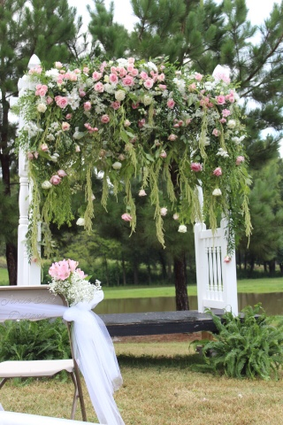 cascading wedding arch flowers
